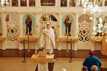 Fr. Andriy Kovach incenses the church and the people